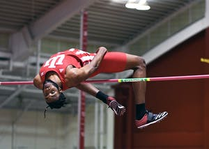 Freshman Jyles Etienne competes in the high jump in the Hoosier Open on Friday afternoon in Harry Gladstein Fieldhouse. Etienne set a new meet record with a jump of 2.21m.