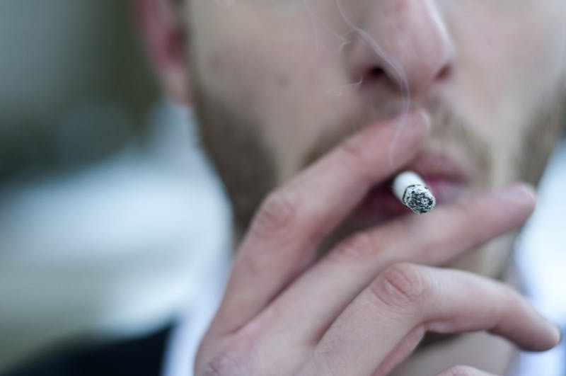 A man smokes a cigarette. The 27th Indiana Youth Survey reported a decrease in vapor and nicotine product use in students between grades six and 12 this year.