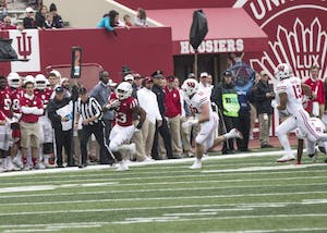 Junior running back Alex Rodriguez runs the ball down the field for IU against Wisconsin on Nov. 4. Rodriguez will transfer from IU before next season.