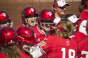 Freshman Maddie Westmoreland celebrates with the team after scoring a home run in the bottom of the third inning. The final score of IU's game against University of Illinois-Chicago was 8-4. The Hoosiers will play Louisville tonight at 5 p.m.