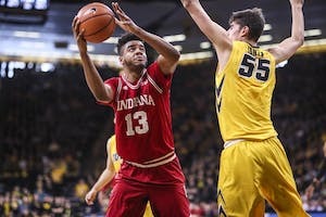 Junior forward Juwan Morgan drives the ball to the basket during the Hoosiers' game against the Iowa Hawkeyes on Saturday at Carver-Hawkeye Arena in Iowa City, Iowa. The Hoosiers beat the Hawkeyes, 84-82, and will play Nebraska on the road Tuesday night.