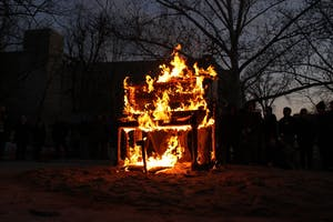 A piano burns on Wednesday evening in Dunn Meadow as an artistic demonstration by composer and artist Annea Lockwood. This performance is part of the Wounded Galaxies festival.
