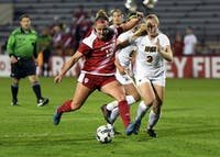 Junior forward Maya Piper scores a goal in the first half against Iowa on Thursday evening at Bill Armstrong Stadium. IU defeated Iowa, 2-1, to earn its second Big Ten win of the season.