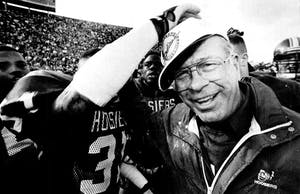 Former IU Coach Bill Mallory celebrates in 1991 after Purdue's place kicker, Joe O'Leary, missed a field goal, which sent the Hoosiers to the Copper Bowl.​ Mallory died Friday at the age of 82.