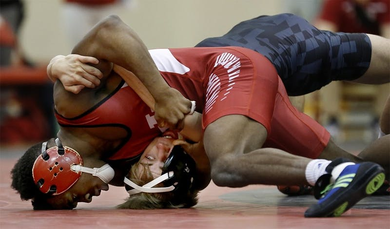 Then-sophomore Elijah Oliver, now a junior, competes in a 125 lbs match with Jhared Simmons from Maryland during the 2016 season at University Gym. Oliver and teammates Cole Weaver, Bryce Martin and Devin Skatzka earned spots in the NCAA tournament from March 15 to 17 in Cleveland, Ohio.