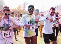 Participants in this year's JB5K Color Run dance at the post-run party. The dance took place on Saturday in front of Student Recreational Sports Center.