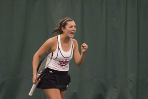 Freshman Michelle McKamey celebrates winning a point during her doubles match with partner Caitlin Bernard. The Hoosiers defeated Rutgers to qualify for the Big Ten Tournament.