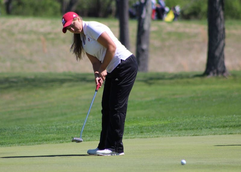 Then-sophomore Erin Harper, now a junior, putts during the first round of the IU Invitational at the IU Golf Course in April. Harper finished 34-over-par after three rounds at the NCAA Championships in Stillwater, Oklahoma.