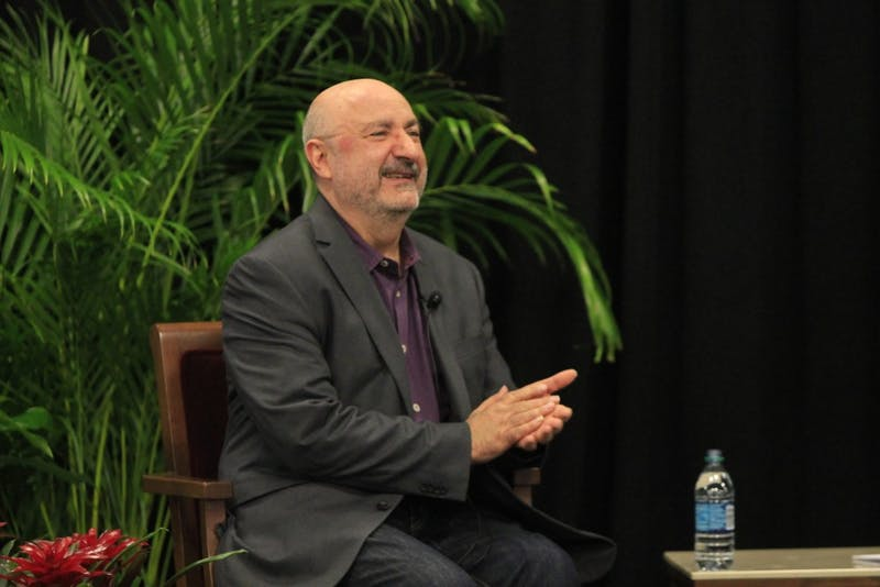 """Author and music critic Anthony DeCurtis applauds English majors before speaking about his book """"Lou Reed: A Life"""". DeCurtis spoke at 5:30 p.m. Feb. 21, in the Solarium of the Indiana Memorial Union."""