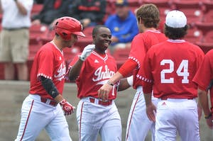 Then-freshman infielder Jeremy Houston, now a sophomore, is congratulated after returning to the Hoosier dugout after his first career home run on April 29. IU defeated No. 20 South Alabama 8-4 Sunday afternoon.