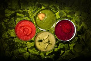 Healthful smoothies (clockwise from left) are Icy Carrot Cooler, It's Easy Bein' Green, Mixed Berry and Beet, and Green 'n Lean.