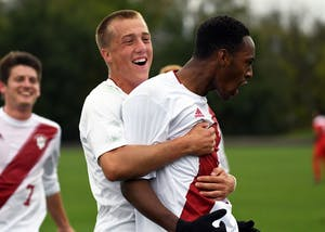 Freshman forward Griffin Dorsey celebrates with freshman forward Mason Toye after assisting on Toye's first half-goal against Ohio State on Oct. 15 at Bill Armstrong Stadium. Per an IU athletics release Friday, Toye will forgo his final three seasons of eligibility with IU after signing a Generation adidas deal with Major League Soccer.