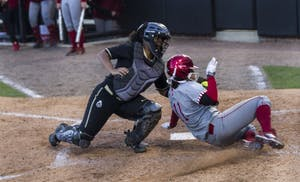 Centerfielder Rebecca Blitz is tagged out by the Purdue's catcher as she tries to make an infield home run. The Hoosiers won both games against the Boilermakers on Wednesday at Purdue in West Lafayette, Indiana.
