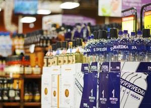 Liquor bottles line the aisles of the alcohol section of the College Mall Kroger. The Indiana House of Representatives passed a bill, 82-10, Tuesday that would legalize the sale of Sunday carryout alcohol.
