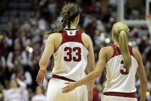 Seniors Amanda Cahill and Tyra Buss walk down the court together between plays against Nebraska. IU defeated Nebraska on Senior Night, Saturday, Feb. 17, winning 83-75.