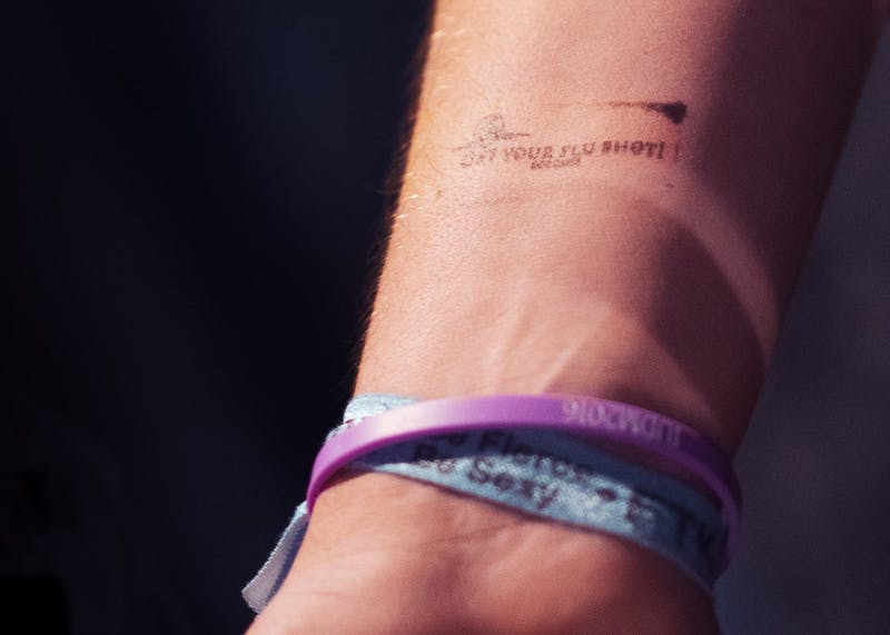 Kilroy's bouncers stamped incoming attendees' wrists with a reminder to get a flu shot on Dec. 7. The stamp was part of an initiative put on by IU human biology students who collaborated on a semester-long project to raise awareness of influenza and advocate for flu vaccinations.