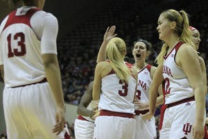 Seniors Amanda Cahill and Tyra Buss celebrate after Buss made a 2-pointer against Nebraska. IU celebrated senior day Feb. 17 at Simon Skjodt Assembly Hall. The Hoosiers will play Iowa in Iowa City on Saturday.
