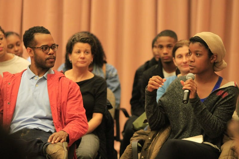 """Students ask questions of dermatologist Dr. Sonya Johnson about how to take care of their skin and hair and what products work best for their skin type. Students and faculty attended the event titled """"Hair Politics: Ode to the Black Barber/Beauty Shops and the Dialogue they Foster,"""" which took place Thursday, Feb. 22, at the Neal-Marshall Black Culture Center."""