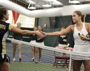 Junior Natalie Whalen shakes hands with her opponent after her 6-4, 7-6 win over Western Michigan University on Jan. 20. Whalen was the only IU player to win her match Saturday at No. 5 Northwestern.