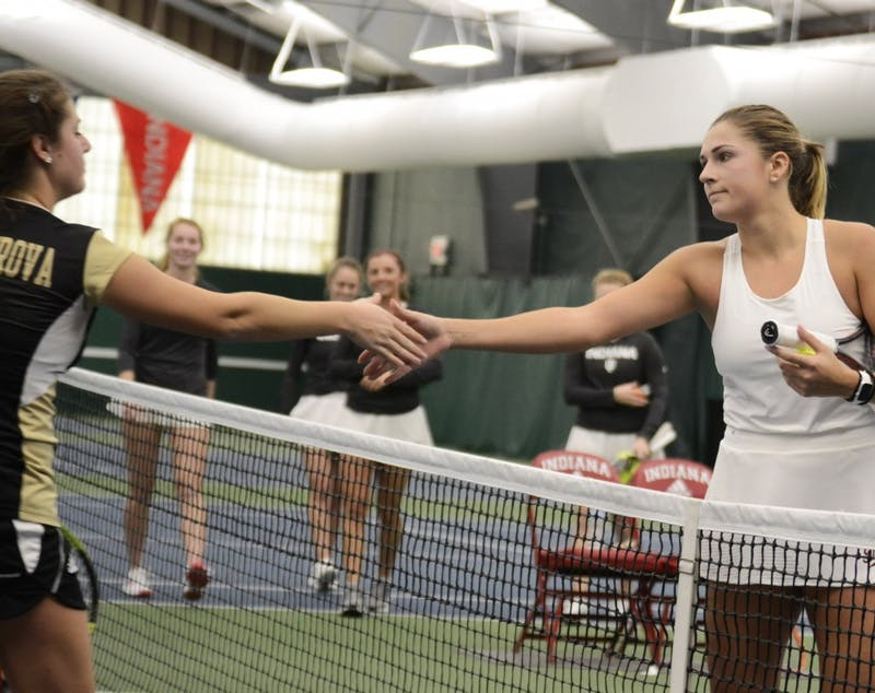 Junior Natalie Whalen shakes hands with her opponent after her 6-4, 7-6 win over Western Michigan University. The team's match against WMU was their first of two played on Jan. 20 at the IU Tennis Center.