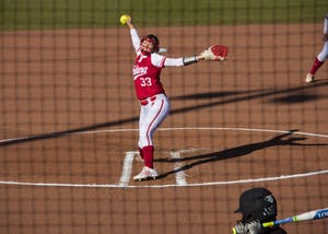 Then-freshman pitcher Tara Trainer, now a junior, throws a pitch during a 2016 game against the University of Louisville at Andy Mohr Field in Bloomington. IU softball will play Louisville again at home during the 2018 season as part of nonconference play.