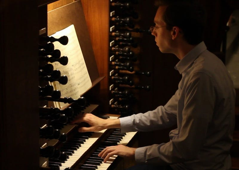 Lucas Fletcher, a doctoral music student, plays a piece on the historic Ehrlich organ Tuesday night. Located in the Indiana Memorial Union's Alumni Hall, the organ is one of the most used public instruments on IU's campus.