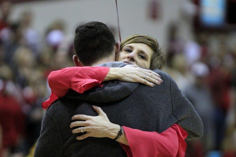 Senior Matt Siegel hugs IU Women's Basketball Coach Teri Moren during Senior Night on Saturday, Feb. 17. Siegel, along with several others, has helped the women's basketball team practice all season.