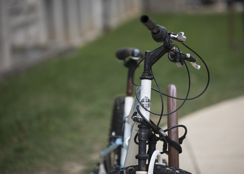 A bike is attached to the rack Tuesday outside Franklin Hall. The City of Bloomington and IU are partnering to start a bike share program that will begin next year.