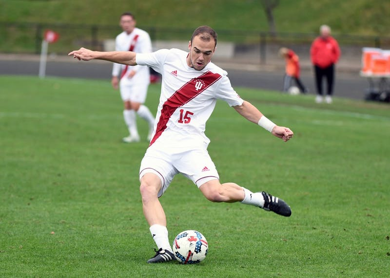 Junior defender Andrew Gutman kicks the ball against Ohio State on Sunday afternoon at Bill Armstrong Stadium. Gutman assisted on Mason Toye's second half goal in IU's 2-0 win over Ohio State.