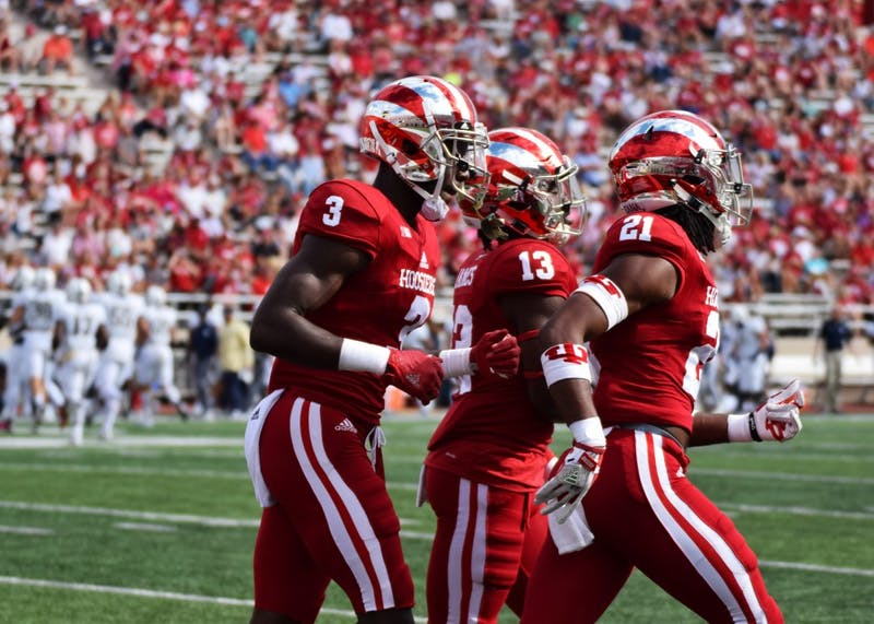 Junior Tyler Green jogs with teammates back to the rest of the team during a timeout in the first quarter of the Oct. 7 game against Charleston Southern at Memorial Stadium. IU's defense shut out Charleston Southern, but failed to record any takeaways in the win.