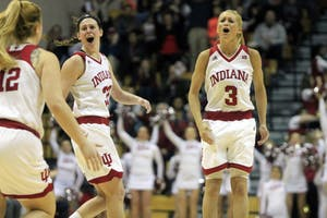 Seniors Tyra Buss and Amanda Cahill celebrate as their team gets a basket against Nebraska. It was the Hoosiers last home game at Simon Skjodt Assembly Hall, and they won 83-75.