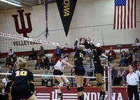 Freshman outside hitter Kamryn Mallory earns a kill against the Iowa Hawkeyes last week at the University Gym in Bloomington. IU lost 3-0 to No. 11 Wisconsin on Friday, dropping IU to 0-8 in conference play this season.