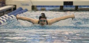 HOPKINSSPORTS.COM The Hopkins women's swim team broke two school records on Friday.