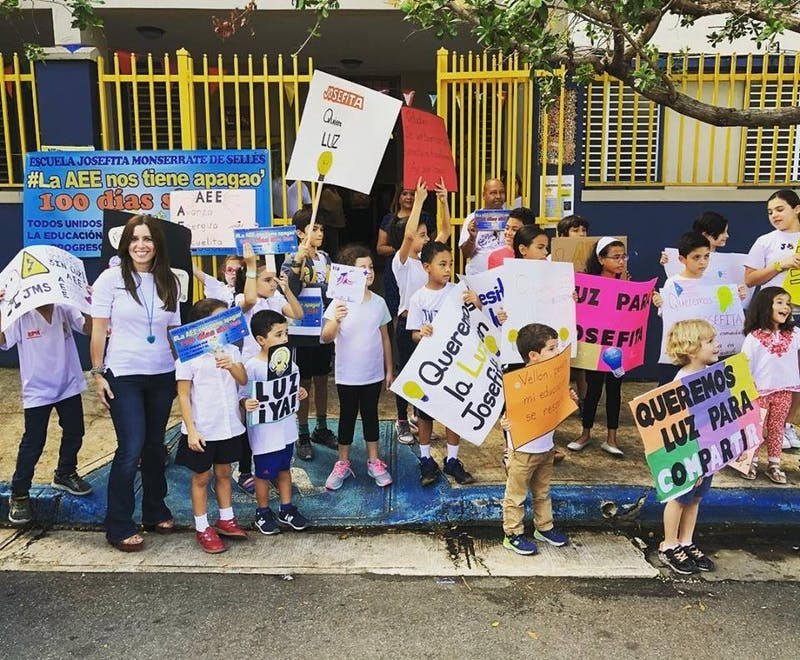 COURTESY OF VERONICA MONTANE Students rally outside a school in Puerto Rico that has no electricity.