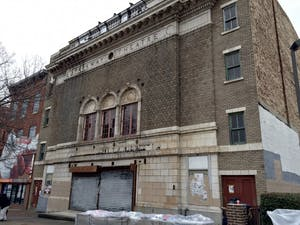 COURTESY OF RENEE SCAVONE The old facade of the theater was replaced with a bright, white exterior.