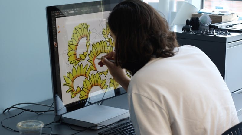 COURTESY OF THE DIGITAL MEDIA CENTER A student works with the DMC's Microsoft Surface Studio.