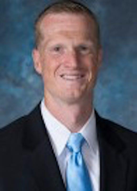 HOPKINSSPORTS.COM Head Coach Josh Loeffler