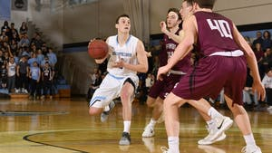 HOPKINSSPORTS.COM Senior Jesse Flannery made two clutch free throws at the end of overtime.