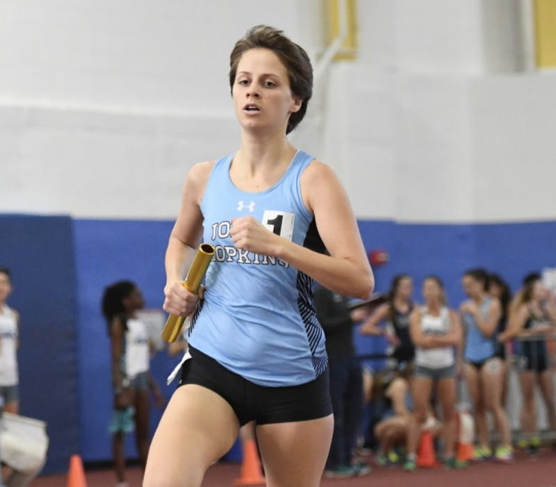 HOPKINSSPORTS.COM Felicia Koerner wins the 3k at the Tufts Last Chance Meet to qualify for NCAAs.