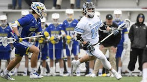 COURTESY OF HOPKINSSPORTS.COM  Junior attacker Kyle Marr scores game-winning shot to lift Blue Jays to 13-12 victory.