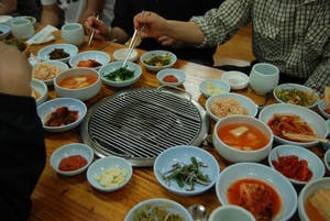 SUKSIM/CC-BY-SA-2.0 Korean barbecues offer a variety of dishes, making them great places for communal meals.