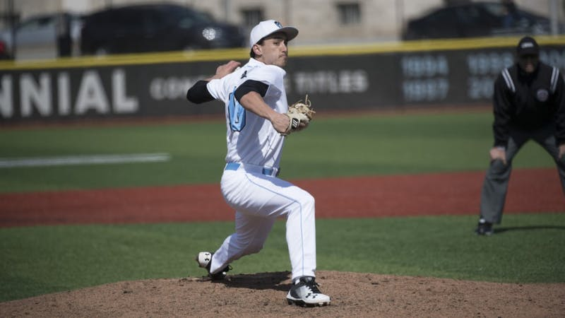 COURTESY OF HOPKINSSPORTS.COM Senior pitcher Alex Ross pitches a complete game against the Muhlenberg Mules, recording a career-high 15 strikeouts.