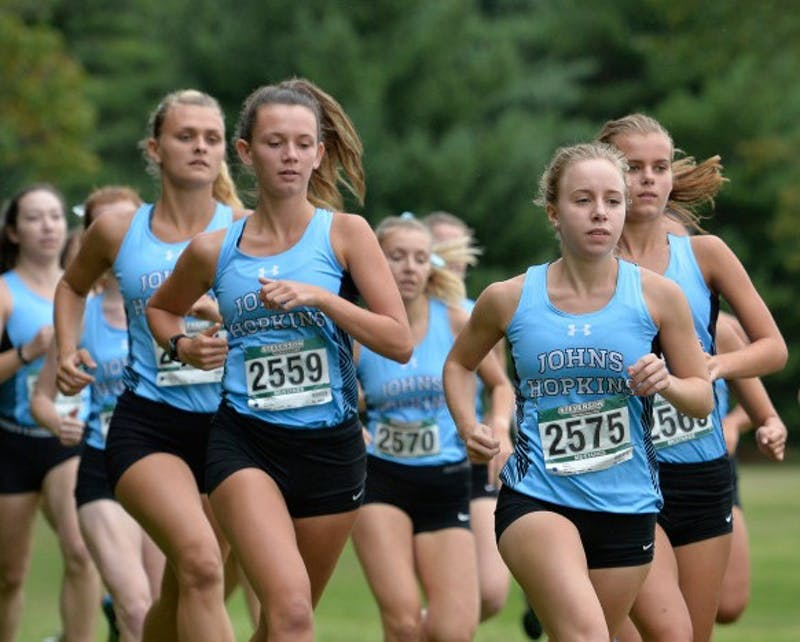 HOPKINSSPORTS.COM The women's cross country team defeated five D-I teams at last Friday's meet.