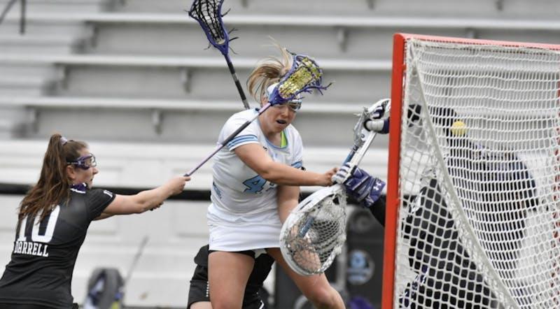 COURTESY OF HOPKINSSPORTS.COM  Sophomore Mackenzie Heldberg scores three crucial goals to help protect the Blue Jay lead.