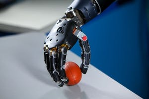 PUBLIC DOMAIN By using stretchable electronics, an artificial hand has been given the ability to sense both temperature and pressure.