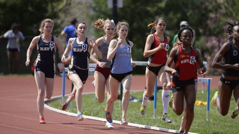 COURTESY OF HOPKINSSPORTS.COM  Senior Caroline Smith crosses the finish line in third place in the 1,500-meter run.