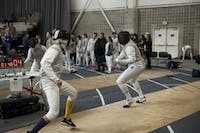SPARDI GRAS: A Brandeis fencer stares down his opponent during a bout in the Eric Sollee Invitational on Feb. 3.