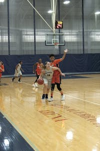 LEADING THE PACK: Guard Eva Hart '18 drives past the defense in a commanding 68-48 win against Salem State on Nov. 28.