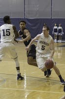 TEAMWORK: Guard Akim Sanni '21 sets a pick for Corey Sherman '19 in a loss against Emory University on Jan. 21.