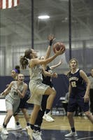 FINGER ROLL FINISH: Guard Camila Casanueva '21 drives past two University of Rochester defenders in a loss on Jan. 21.